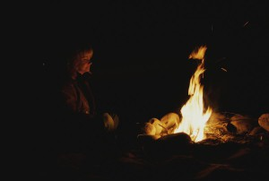 woman-at-a-campfire-at-night-todd-gipstein